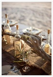 Bottles and Driftwood Centerpiece for beach wedding