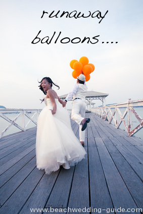 runaway balloons beach wedding photo