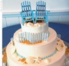 Relaxing on the beach themed wedding cake