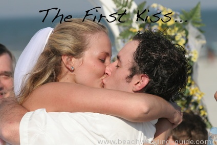 first beach wedding kiss