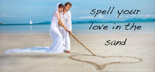 writing in the sand beach wedding photos